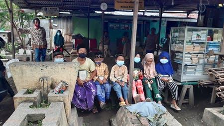 Banner program Wujudkan Rumah Quran Makam Rangkah Surabaya